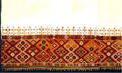 Woven bedcover from Crete, densely decorated with loom embroidered geometric designs in vivid colours. 19th c. (ΕΕ 3164) image and text Benaki Museum