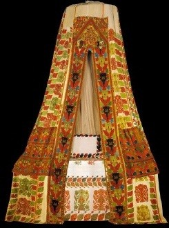 Multi-coloured embroidered sperveri (bed-tent) with spectacular foliate decoration, flower-vases and peacocks. From Rhodes island. Among the few surviving examples, this is the best and the best preserved. The workmanship combines sumptuous style with excellent execution, the strict compilation of an overall pattern with echoes of Byzantine splendour, and radiance of a joyous sensation with the sensory nature of the neo-Hellenic mode of expression. 17th-18th c. H. 4, circumference of lower border 10 m. Gift of Helen Stathatos. (ΓΕ 7650) image and text copyright Benaki Museum