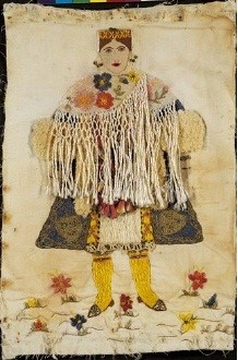 Embroidered depiction of a woman wearing the costume of Kastellorizo, a Dodecanese island. A primitive rendering of one of the most impressive of all Greek costumes. 0.45x0.30 m. (ΓΕ 23828) image and text copyright Benaki Museum
