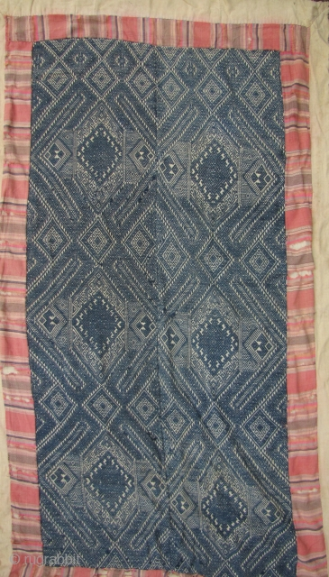 Nice old Laotian blanket from the Tai Dam ethnic group. The embroidered face and backing is made from all hand spun and hand woven thread. The border is frayed but the center  ...