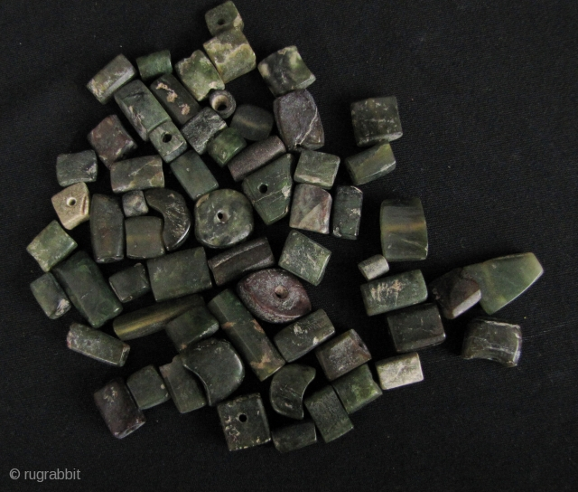Lopburi Aventurine Beads: 65 loose Bronze Age (500 BCE- 500 CE), beads from Thailand- unstrung and laid out they are about 74cm/29in and weigh 75 grams. Very difficult to find a full  ...