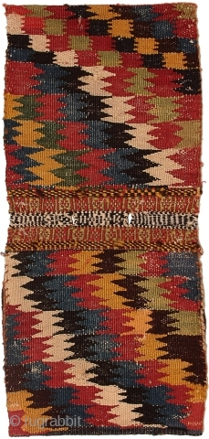 Colorful flat-woven back of a Qashqai chanteh.