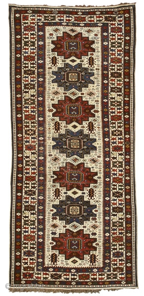 """White ground Shirvan rug with Lesghi stars Northeast Caucasus circa 1850 257 x 105 cm (8'5"""" x 3'5"""")  Alg 1587 symmetrically knotted wool pile on wool warps and cotton wefts It has been by now ascertained that  ..."""