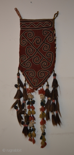 """Central Asian Embroidered Felt Bag, Wool, Animal Hair, 20th Century, Bag alone is 22.5 x 11, with tassels and attachments it is 48"""" long.  One morning many years ago when I  ..."""