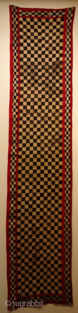 very unusual Kuba ceremonial rug form Congo with chequerboard design size 245 x 54 cm mid 20C.  Each square is individually hand stitched from a square of woven raffia with sides  ...
