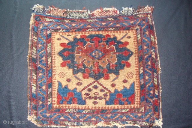 An Old Afshar bagface with a unique design on a unusual light camel background. The designs remind me of the Ningshia wave at the bottom with a Turkish Smyrna medallion. 23inches x  ...