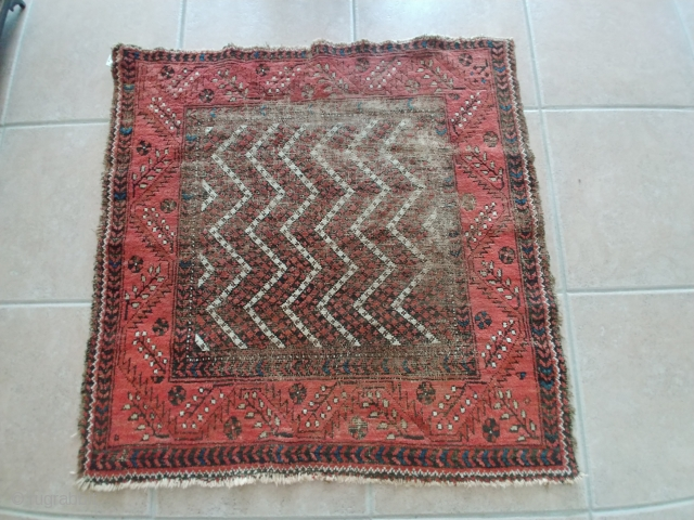 Rare piled Baluch Soffreh or Ru-Korsi with an unusual border. A bit battered but yet collectible. 41 inches square or 104cm square.  If you click on Anthony Fahmie's pages link found  ...