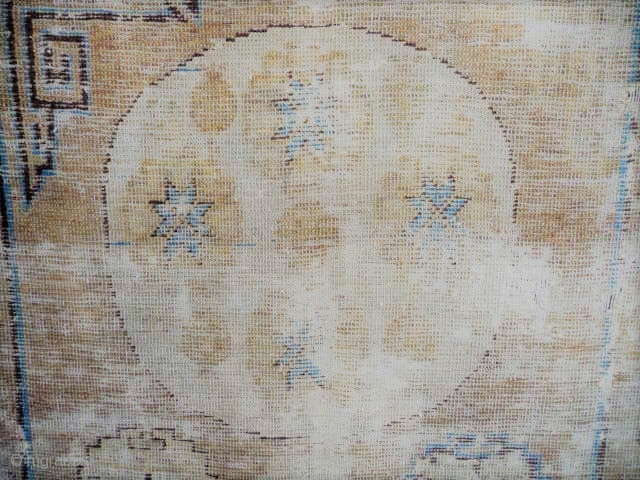 Khotan  :beautiful early rug 18/19thc. faded logwood, complete, not rotten, pretty knackered