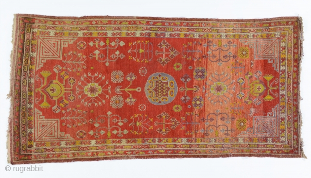 Khotan/Aksu carpet, Chinese Turkestan, early 1900's, 277 x 137cm, warps and wefts are cotton. Condition is very good for its age, tiny hole to the left of the centre, pile full, small  ...