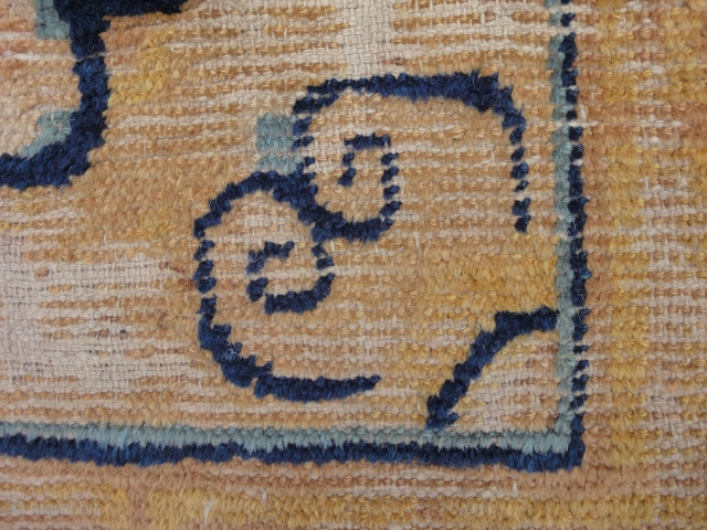 A fine Chinese fragment. Very oxydized brown, low or missing pile, cm 39 x 40. Between 17th and 18 cent.