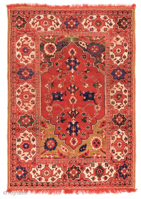 Lot 34, Transylvanian rug with Star-and-cartouche border, Turkey mid-17th century