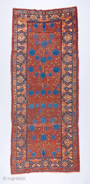Great 18th century Khotan pomegranate long rug. The drawing is dynamic and alive . Some scattered repairs and touch ups but almost all original .