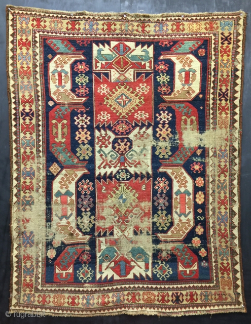 "Antique Caucasian rug. Size 5'4""x6'10"". Distressed, but very attractive. Please ask for more photos or information."
