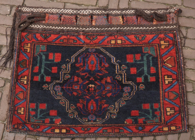 Afshar bag with tulips, in very good condition, wonderful colours, the back is not original but fits well.  77 x 59 cm.