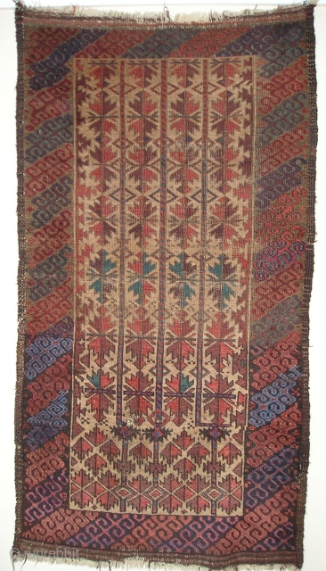 Camel-Ground Baluch rug . Perhaps Bahluli according to recent research. (see the current issue of Hali) Colorful latch-hook border (interestingly, there are no minor borders) and a great rendition of the classic  ...