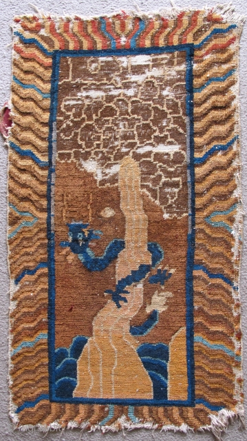 Chinese Rug with Dragon coiled around magic mountain reaching into the clouds. Fantastic iconography with clouds and phallic mountain jetting out of the sea. Not ancient but very fun, probably Deco period.  ...