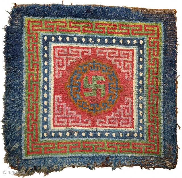 """Large Tibetan seating square. Excellent natural colors including a fantastic abrashed green and a pink/purple that may be lac or madder. wangden-esque with an open knotted back. size is 35""""x34"""" / 89x87cm"""