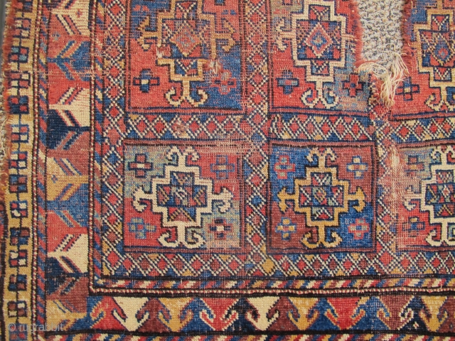 Colorful older square-shaped Quchan Kurd rug from Khorosan. Aina gul design field, superior color. Condition is... well... um... 'poncho-fied'?