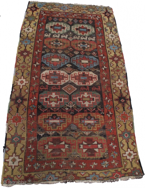 "Northwest Persian Kurd rug with Memling guls, animals and flowers on a dark ground. Camel ground border with good color including several greens and aubergine.  3'9""x6'10"""