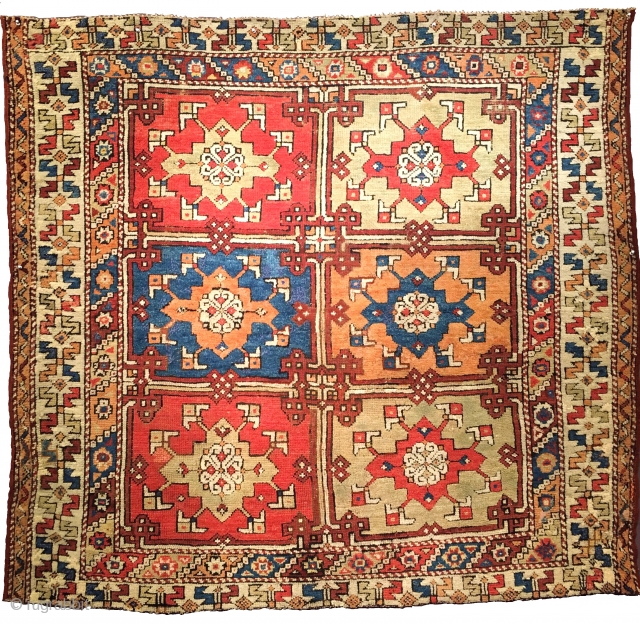 Northwest Anatolia / Bergama area Yuntdag rug with iconic Holbein strap-work design. Great use of complimentary contrasting color. About 5' square.