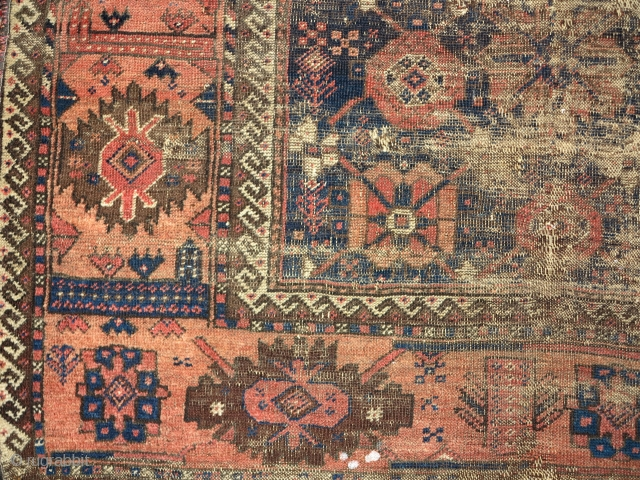 Ancient minakhani Baluch rug. (price not commensurate with condition)