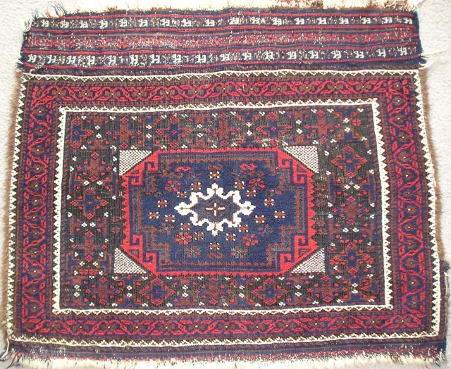 'Arab Baluch' Bagface from Khorossan. 19th century. Former Anne Halley Collection piece. asymmetrical knots open right with highlights in purple and green silk and great saturation of natural colors. Much of the  ...