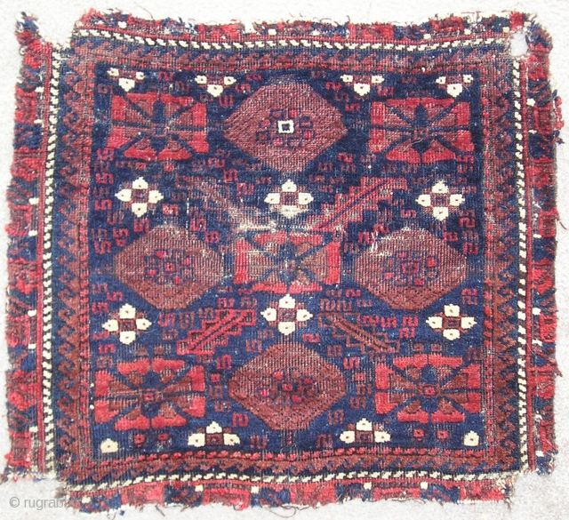 Baluch minakhani bagface ( khorjin fragment ) with saturated color and interesting features for the structurally inclined including alternating bands of Turkish and Persian knots and a pronounced pattern of weft shifts  ...