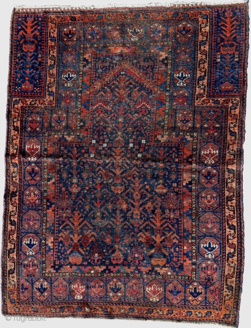 """ Timuri "" type Baluch prayer rug with a rare pointed mihrab niche flanked by animals. A very unusual Baluchi. Restoration to field and sides."