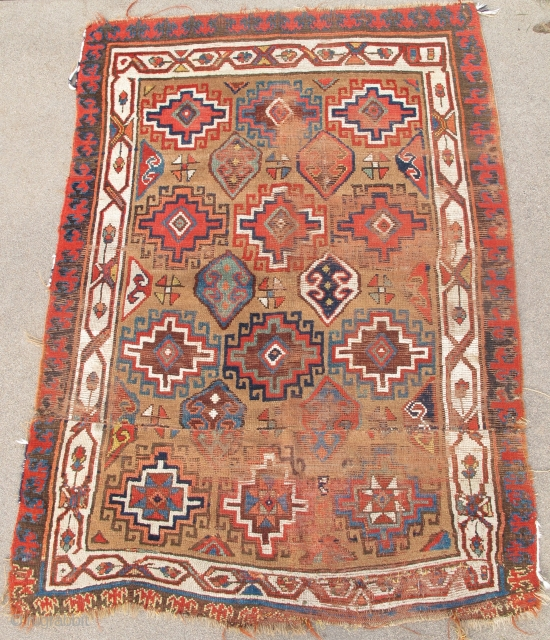 Northwest Persian Rug, Kurdish or maybe Shahsevan? Memling gul design on camel ground with great colors. The whites towards the bottom are cotton. The piece is cut and shut but the resulting  ...