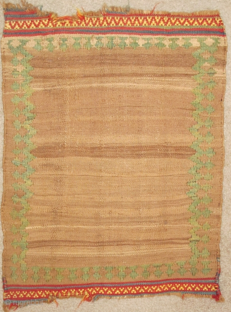 Miniature Minimalist South Persian Kilim with a natural abrashed camel ground and pistachio green border. Perhaps a small sofreh, cover or bread cloth. There are remains of knotted warps on either end  ...