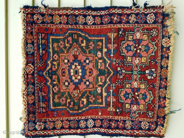 "Karadja mat - about 21"" x 23"". Unusual format.  Beautiful saturated colors. Good pile. Ends/sides unravelling."