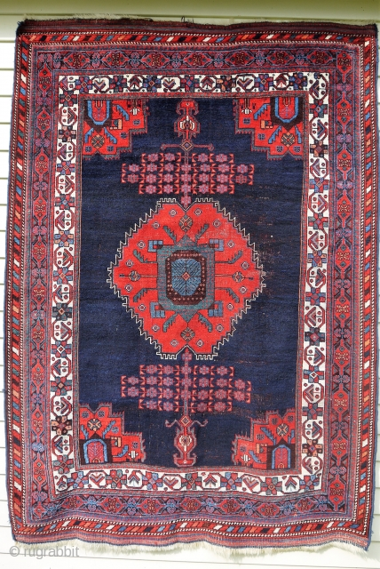 "Afshar - about 4'10"" x 6'9"". Beautiful color and nicely executed 'beatle' medallion and corner spandrels, but not without some scattered central wear."
