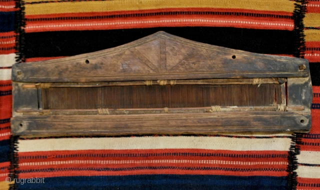 Two Mazandaran jajum-combs. Probably early 20th. Small 56 x 20 cm. Larger 71 x 20 cm. Carved wood and reed. These combs were opened from the upper side, inserted into the warps  ...