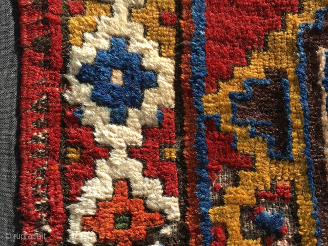 Detail of Konya Karapinar/Karacadag village rug fragment. 1810/1830. Gorgeous colors, bold geometrical design. Great Anatolian collector's piece. For full view, photos, infos pls see the link: http://rugrabbit.com/node/165992