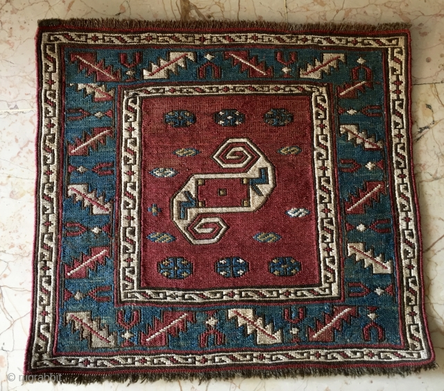 Dragon sumac khorjin bag face. Baku area, Xizi? Cm 33x36. Second half 19th c. A main dragon in the center and tens of dragons in the border. Iconic, small fine sumack weave  ...