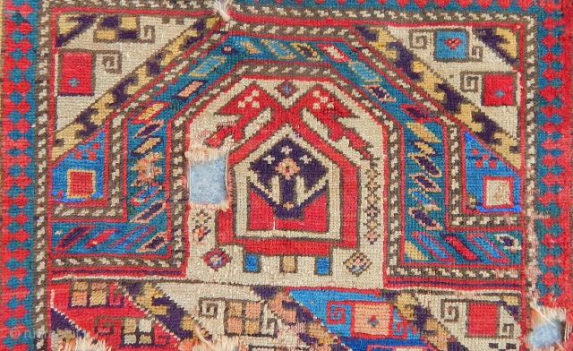 Colors. If you are after colors here you are served. This is a Caucasian prayer rug who suffered a lot, but it's still fresh like on the first day. If you are  ...
