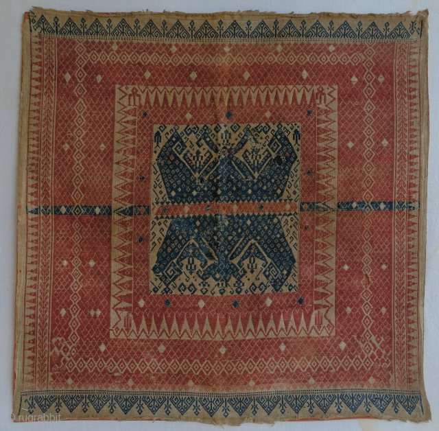 Tampan ceremonial textile from Lampung region, Southern Sumatra.  76 x 77 cm. Backed with a cloth.  Condition: Three small holes, backed with a correct color cloth (rust, blue), some wear over the  ...