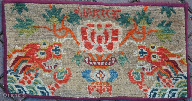 Unusual Tibetan piled panel with dragon heads and inscription. A very pretty item with soft shiney wool, about 1x2 ft. Probobly first quarter 20th century. Price includes word wide shipping, not being  ...