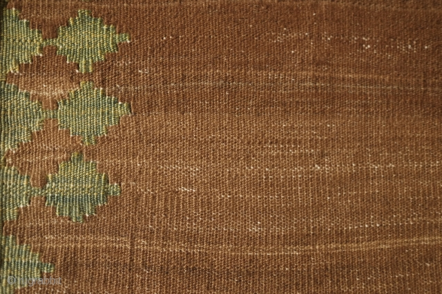 Qashqai small sofreh, 19th Century. Variegated camel wool ground and natural yellow-green in a reciprocating trefoil border motif, and red and blue in the nested fork soldat ends.  It would have  ...