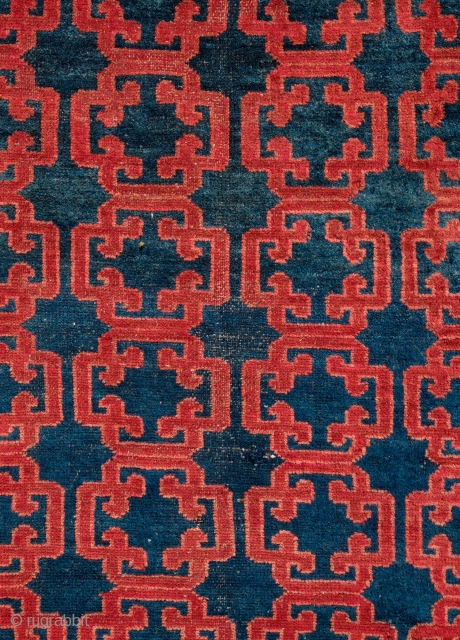 Kyrgyz Rug, 1900.  Khotan-Ningxia cloud-lattice design in the field.  The lighter spots on the image of the main rug are due to sun spots shining through the shade.  There  ...