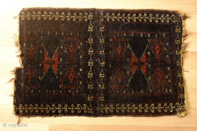 Baluch double-compartment bagface. Unusual.  A bit beat up and low but nice soft pile.  36 x 57cm.