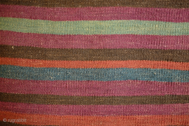 Kohistani saddle bag from Badghis area of Afghanistan.  Late 19th Century.  This has a beautiful striped back in natural colors.  Colors are all good.  Some of these bags  ...