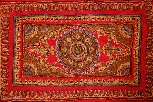 Kerman Embroidery Wall Hanging, Late 19th/early 20th Century. Good colors and workmanship. Loom woven wool ground cloth. Original cotton backing. Metallic thread fringes all around the edges. A gorgeous piece that strikes  ...