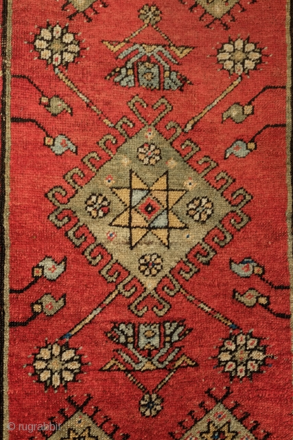 Konya-Ladik yastik, mid-19th Century, A nice composition with a Seljuk star in the middle.  Corner triangles are reminiscent of the 16th century transition of animal motifs to geometrical abstractions in Turkish  ...