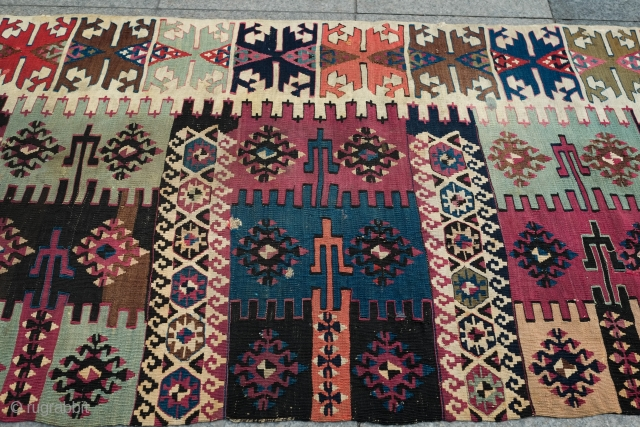 Reyhanli Saf long kilim, one side. Fourth quarter of 19th century.  Beautiful pistachio green, a lovely apricot and some cochinieal.  A few repairs and a couple of holes.  345  ...