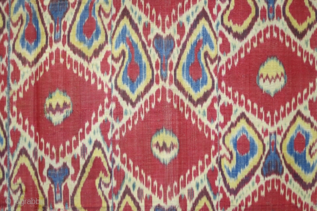 Uzbek ikat wallhanging, Bokara,silk warp, cotton weft, with main pattern of large red medallions, original block printed lining, 57 x 82 inches (140 x 208 cm), 19th century. Very reasonable price.