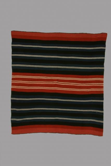 Mantle (iscayo) Aymara indian, Bolivia, alpaca wool, 18th/19th century, some small areas of restoration/reweaving, 40 x 44 inches.  This is a strikingly graphic example of the type with fine white lines  ...