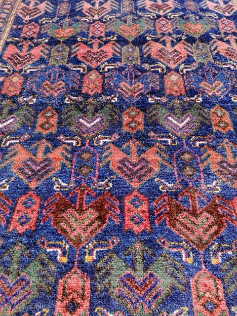 Object: Kurdish Hamedan rug.  Manufacturing area: North West Iran.  Pattern: The midfield consists of a repeated bird/eagle pattern in different colors. The main border consists of stylized flowers, leaves and bothe figures. The secondary  ...