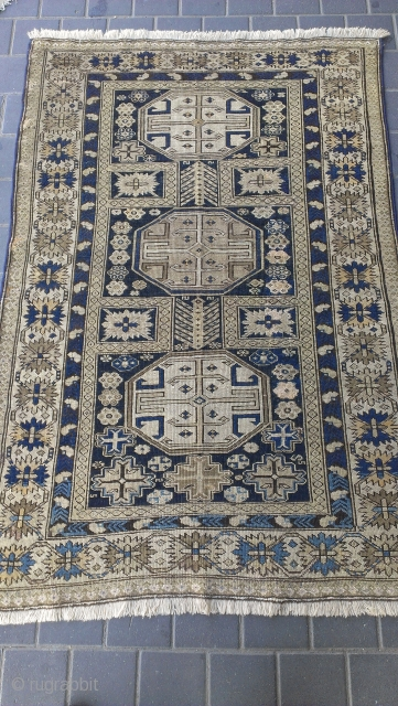 Caucasian rug have a reaiper size: 160x109-cm , synthetic colors faded.