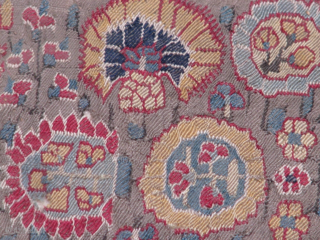 This fragment is a very old textile from Iran(kerman),1800's piece for sure its backed up with some other cloth and cotton in between